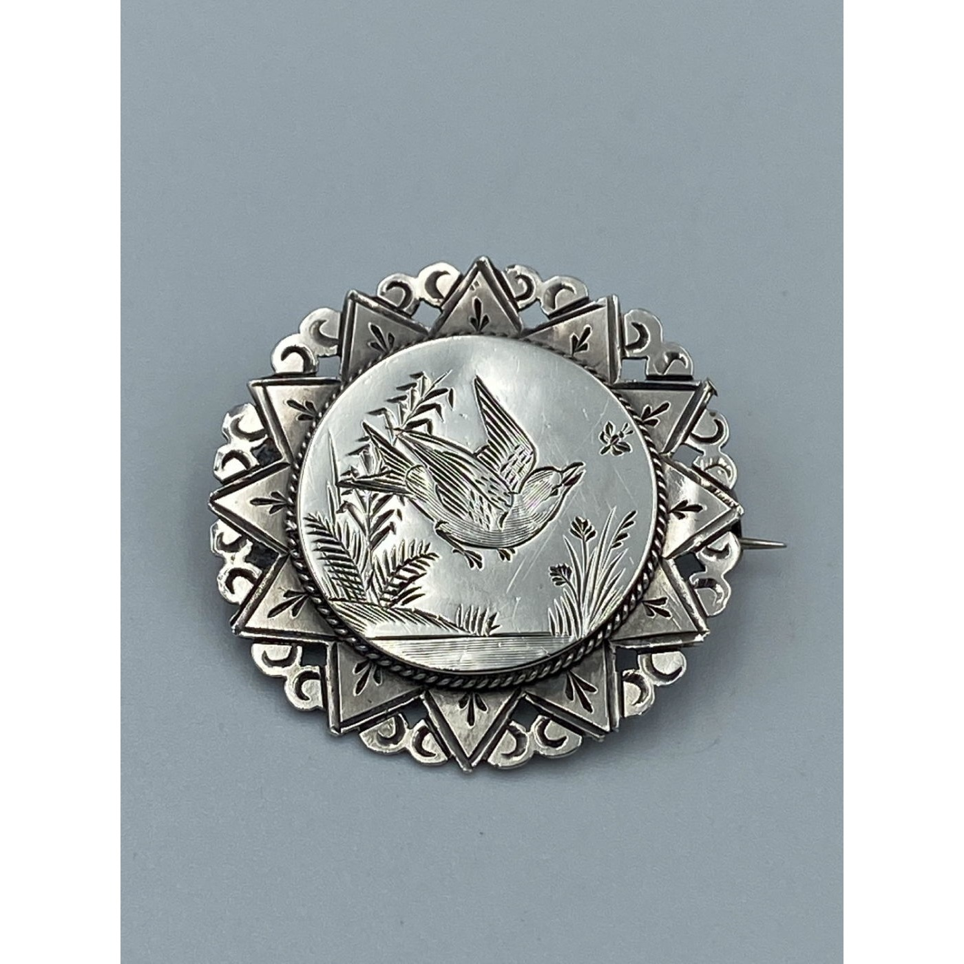 Lovely Round Victorian Pin with Large Center Swallow Bird in Flight