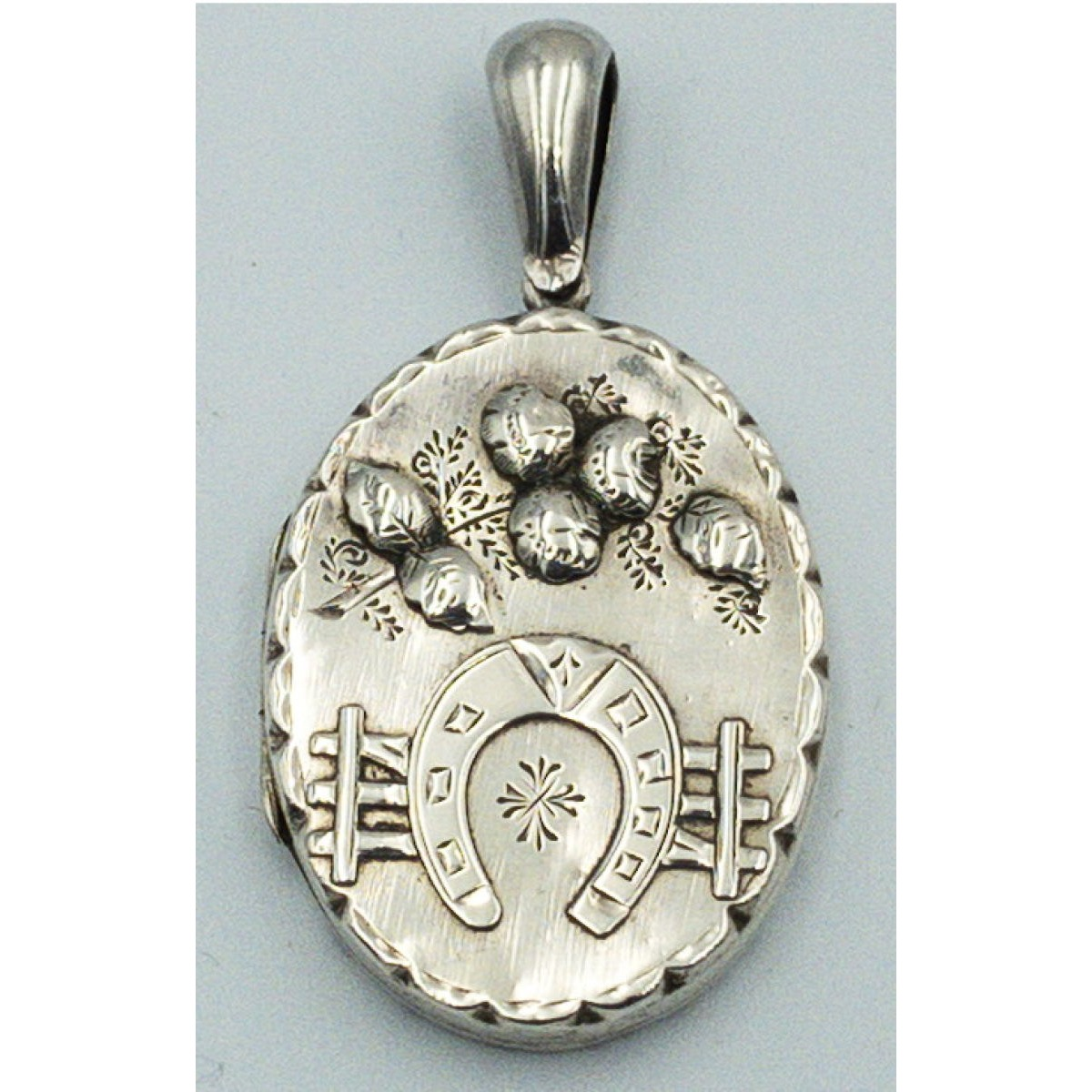 Spectacular Horseshoe and Applied flowers Antique English Silver Locket