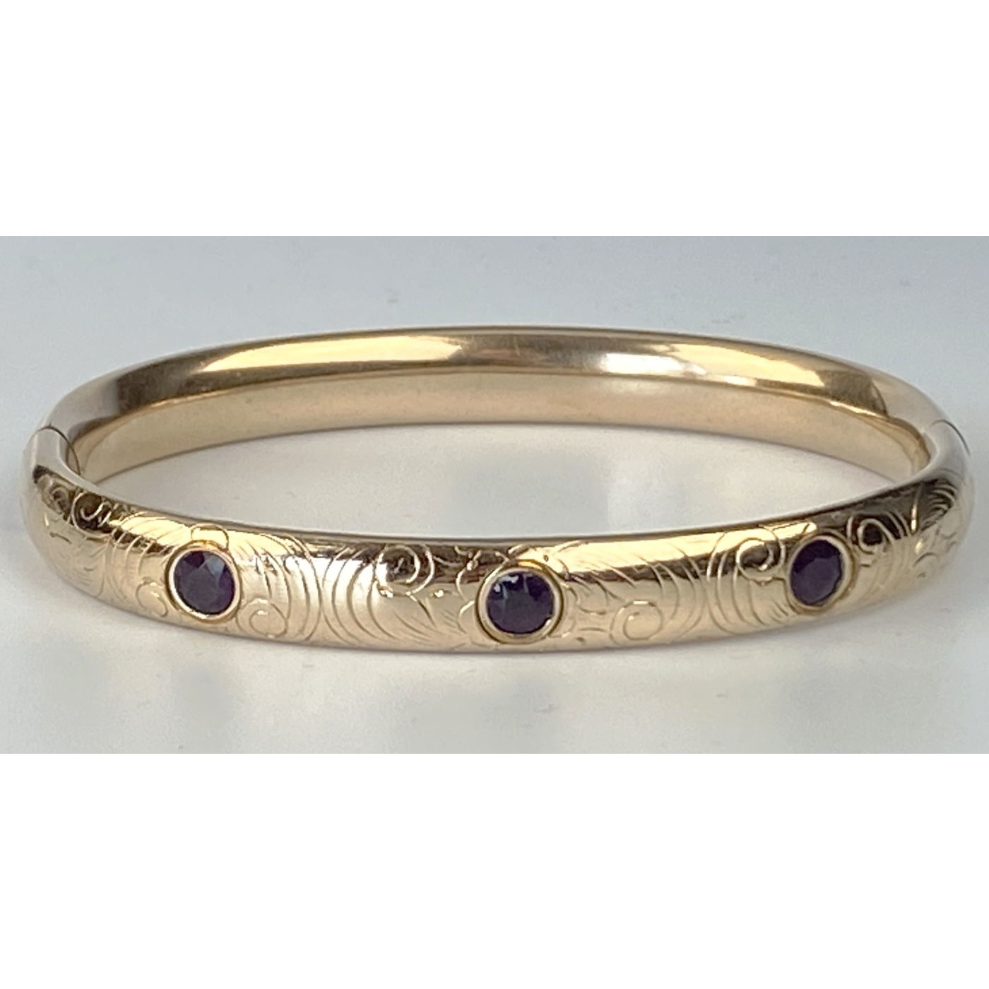 Beautifully Engraved Engagement Bangle with Three Deep Purple Stones