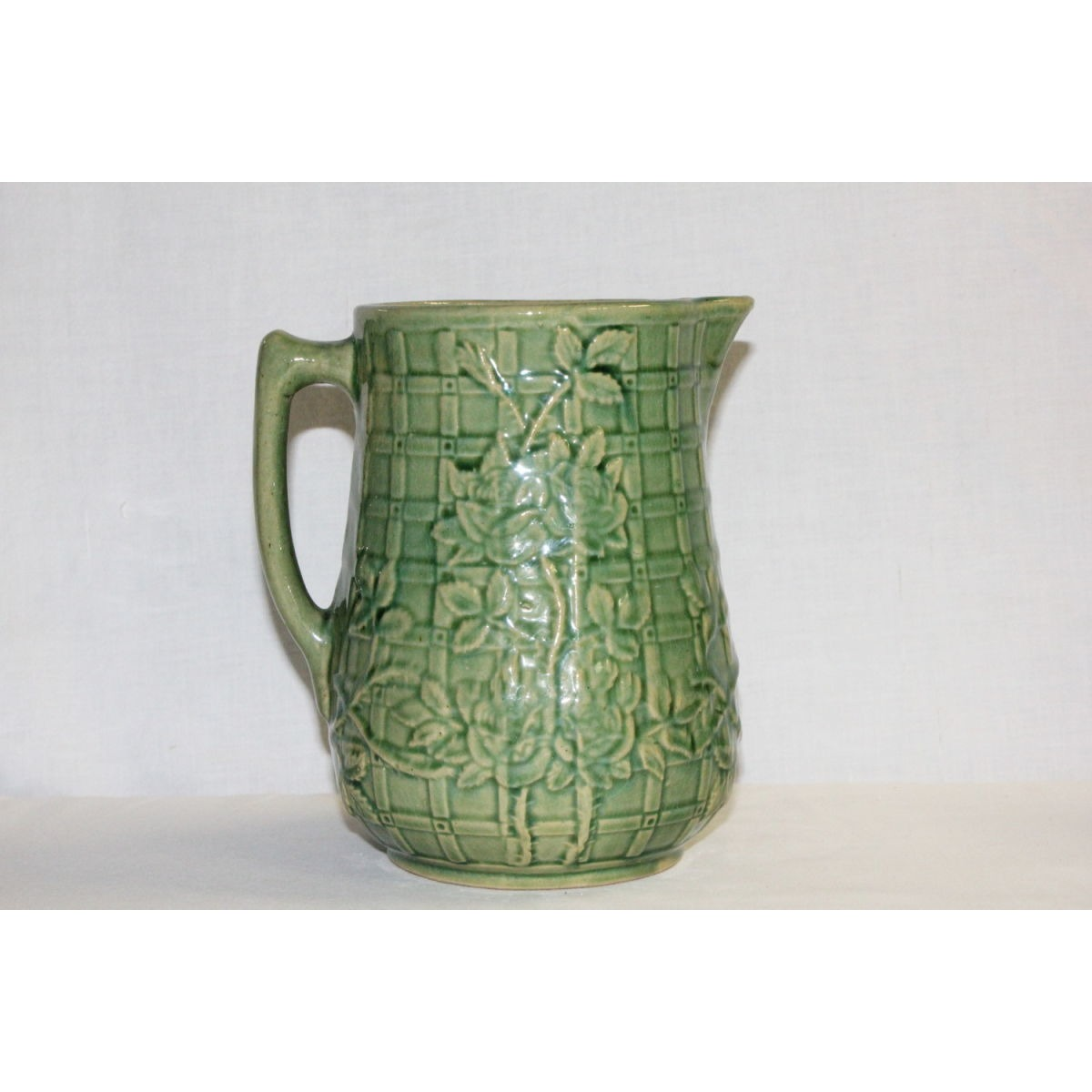 Large Lovely Green Glazed Yellowware Rose on Trellis Pitcher
