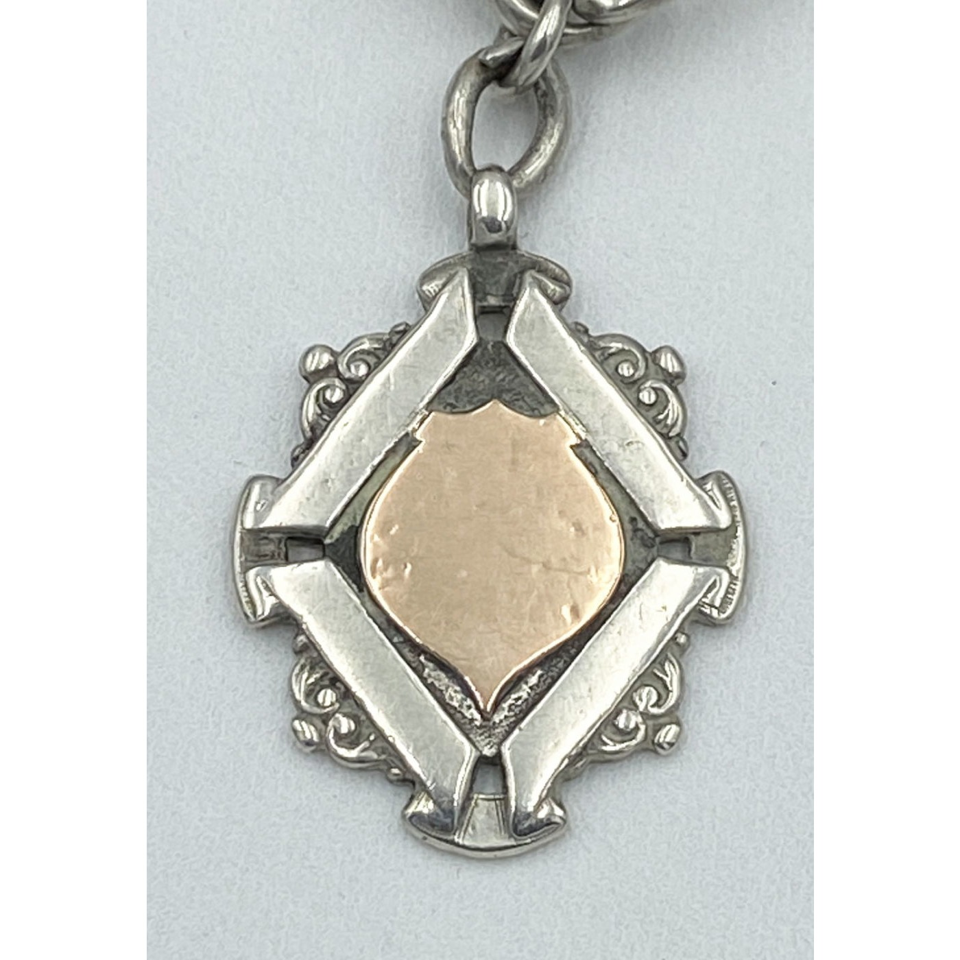Excellent Diamond-Shaped Silver and Rose Gold Medal