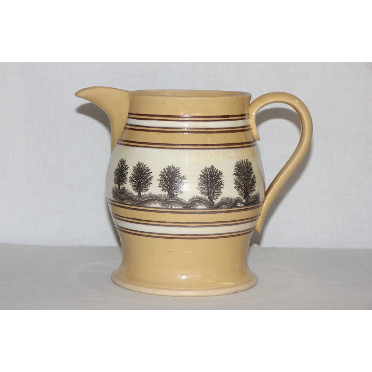 Stunning Black Decorated Yellow Ware Pitcher - Trees