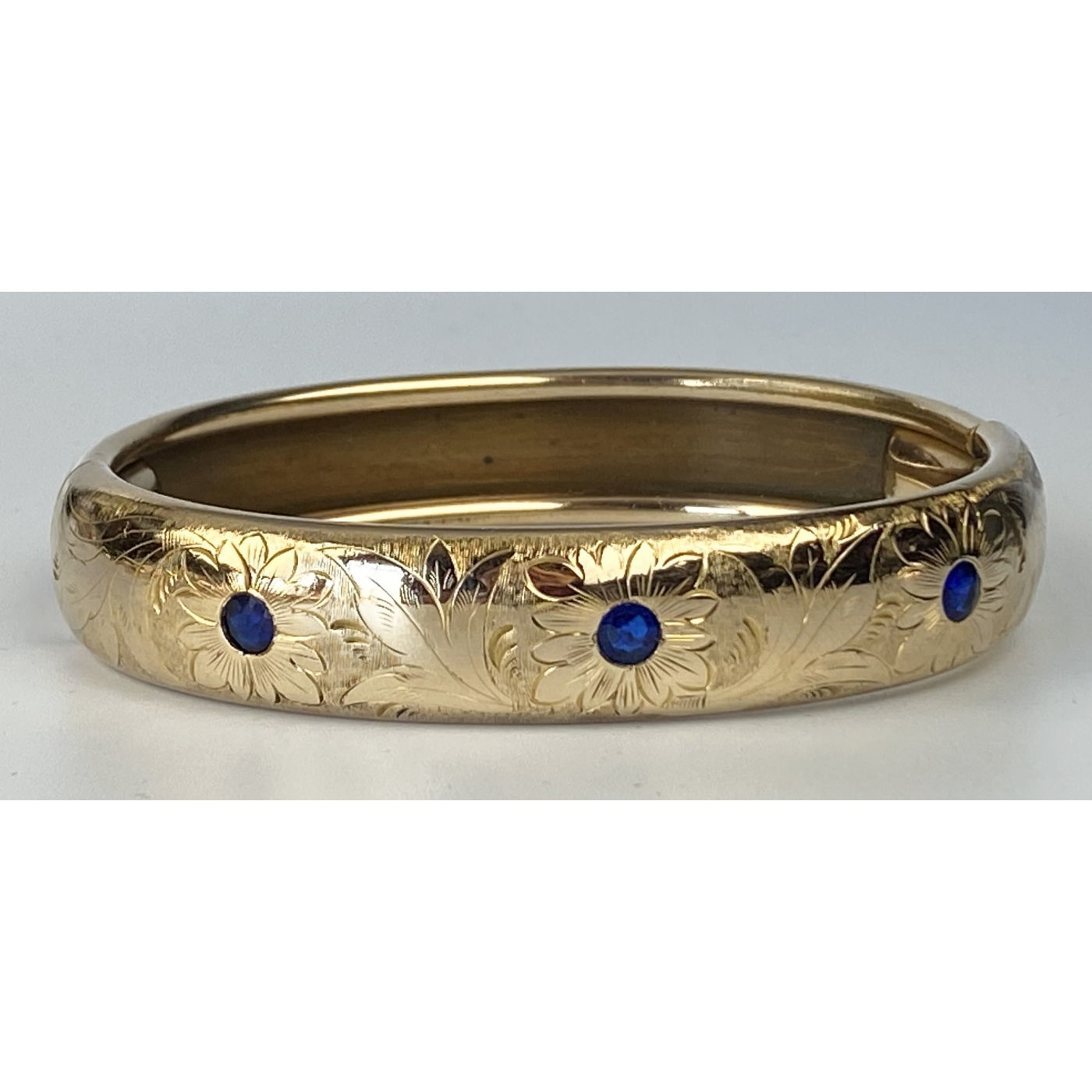 Brilliant Blue Stones and Floral Engraved Engagement Bangle