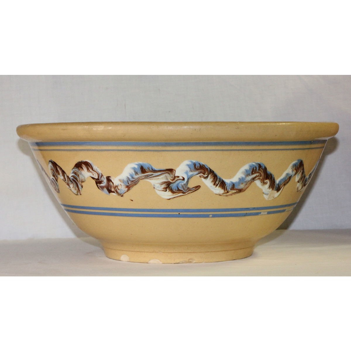 "Massive 15.5"" Blue Earthworm Yellow Ware Bowl"