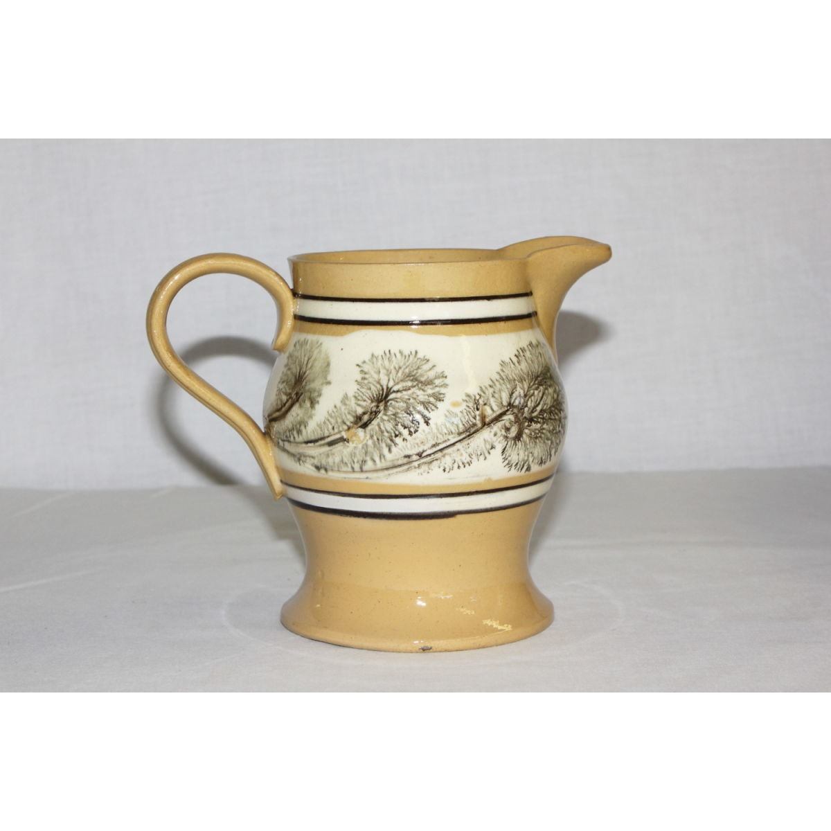Highly Unusual Black Green Seaweed-Decorated Yellow Ware Creamer