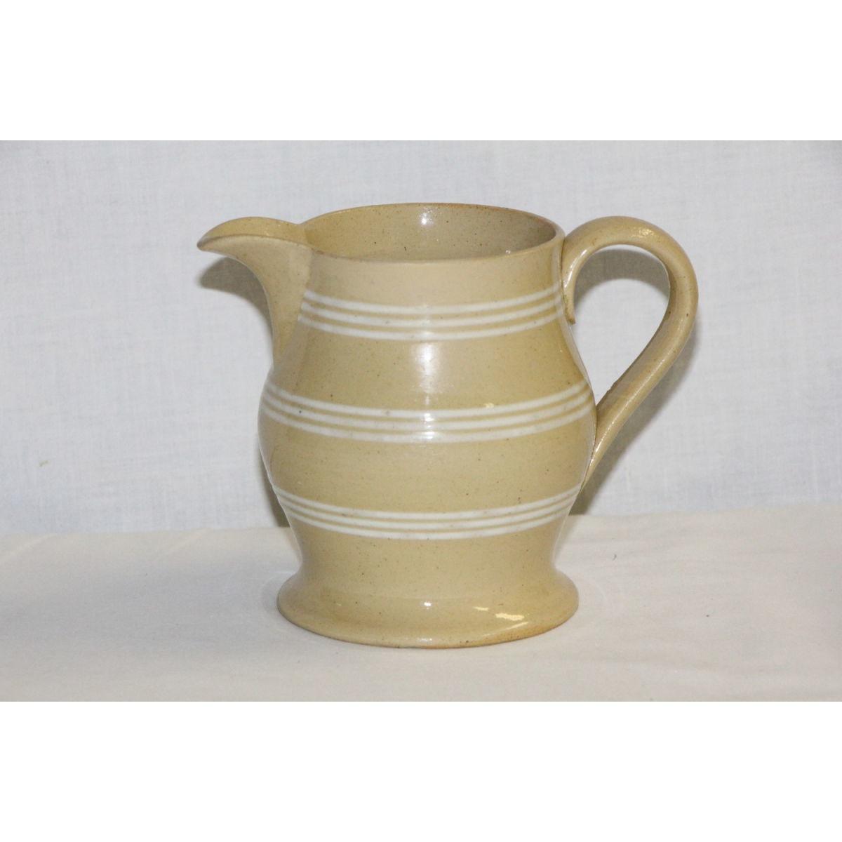 Lovely 9 white banded Yellow Ware Creamer