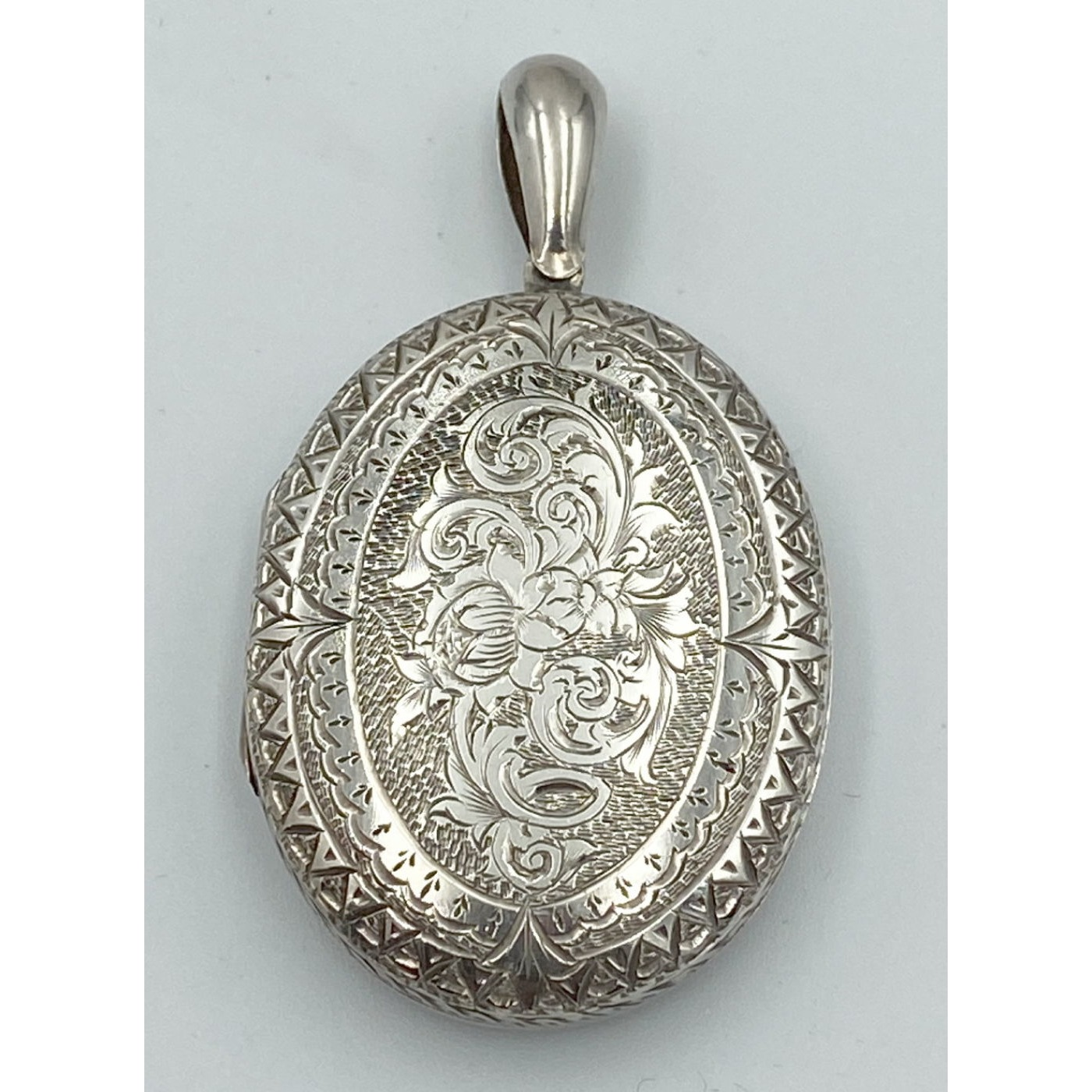 Ornately Adorned Floral Two-Sided Medium Size Antique English Silver Locket