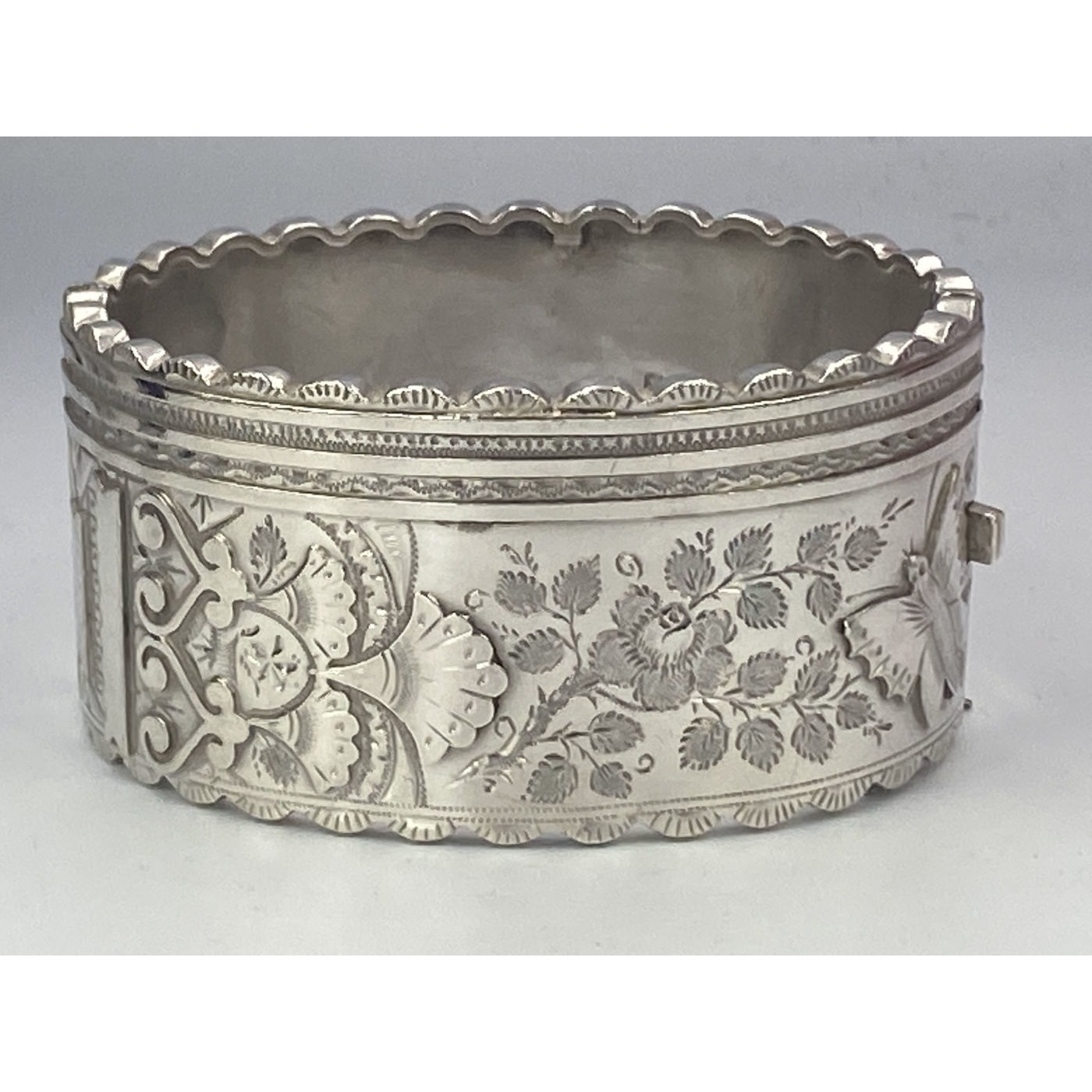 Scalloped Edge with Hearts, Flowers, and Butterfly Antique English Silver Bangle