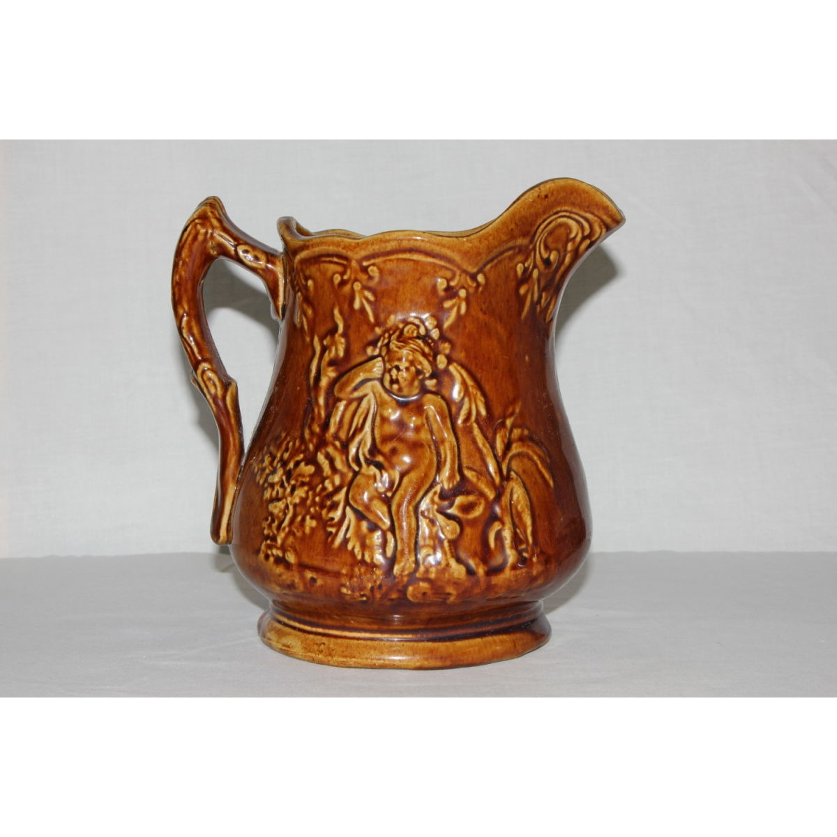 Quirky Cherub Rockingham Glazed Yellowware Table Pitcher