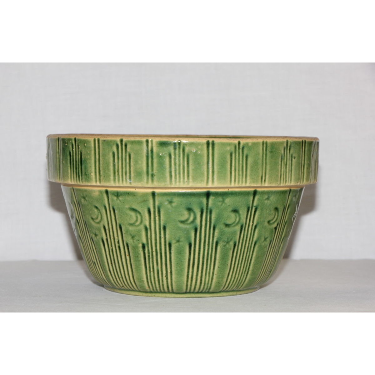 Incredible Green-Glazed Yellowware Moon and Stars Bowl