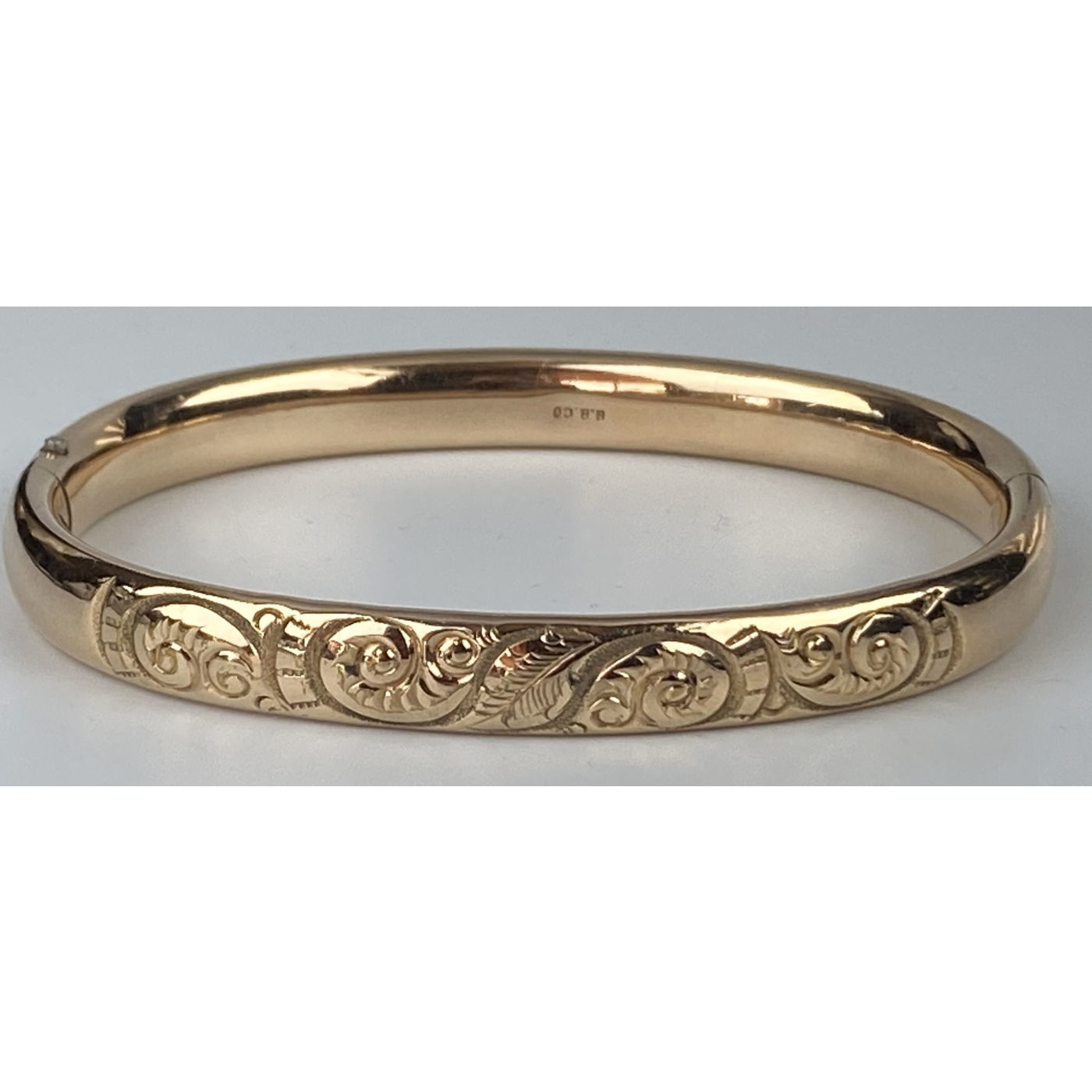 Narrow Larger-Than-Average Deeply Engraved Engagement Bangle