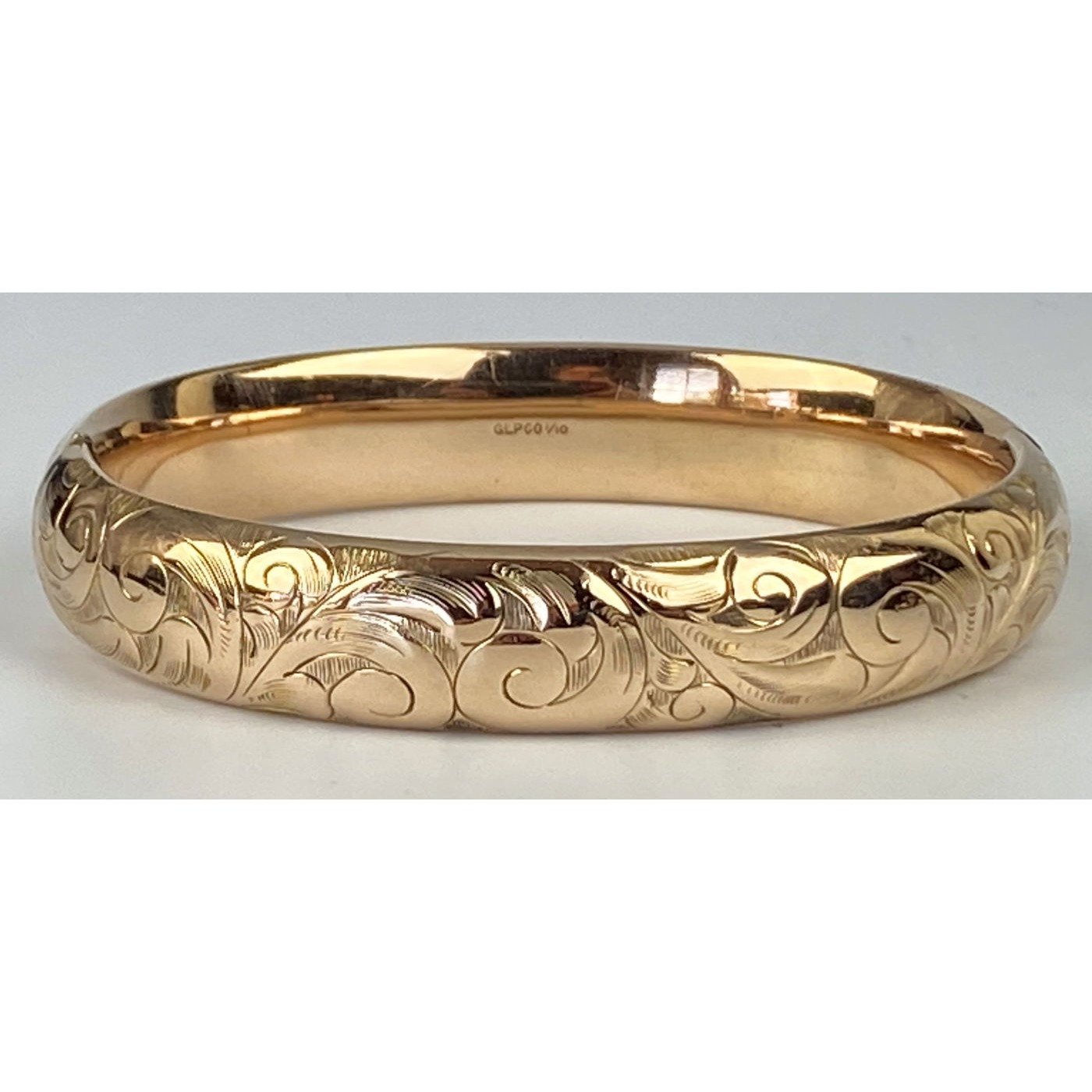Deeply Engraved Swirls Highly Domed Engagement Bangle