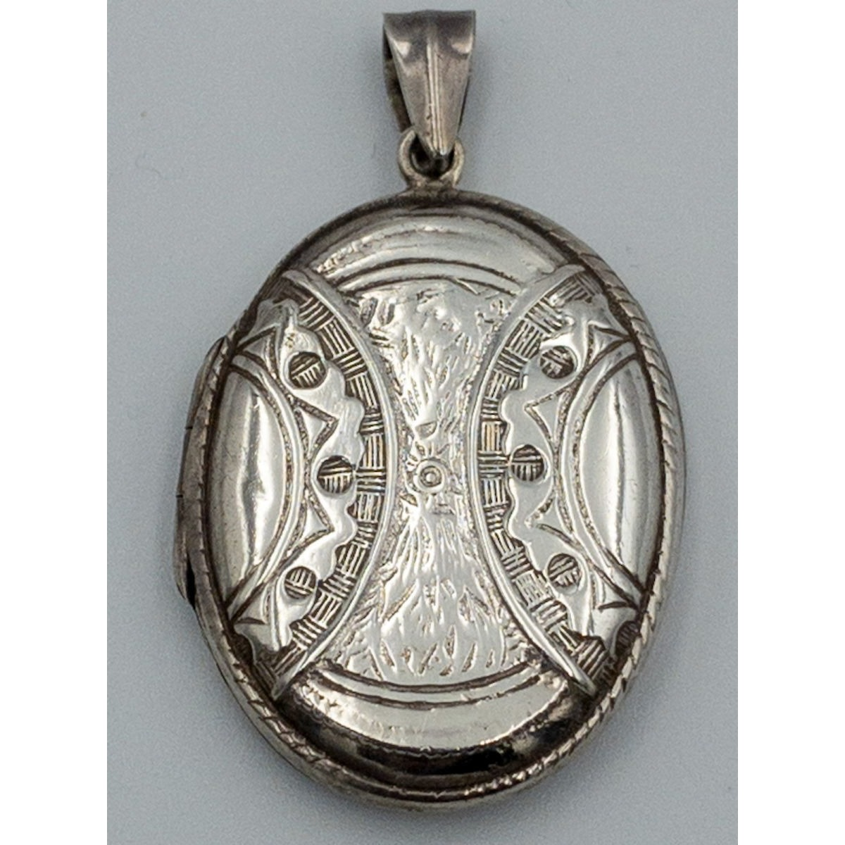 Small Flat, Interesting Curved Bands and Overall Decoration Antique English Silver Locket