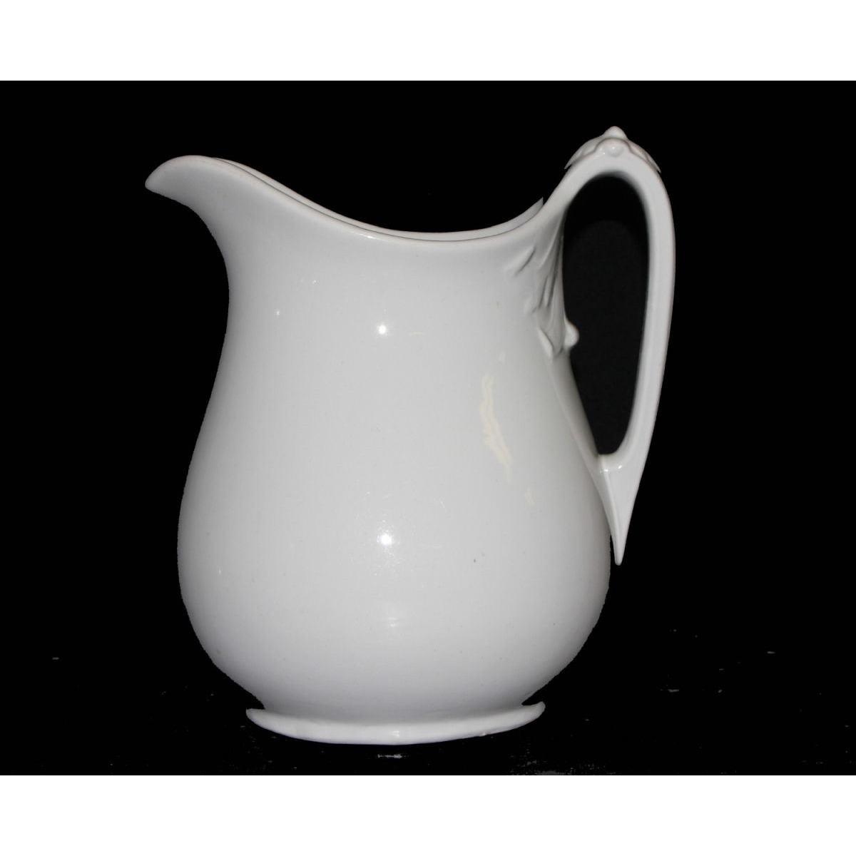 Plain Ironstone Milk Pitcher with Exaggerated Scroll under Handle